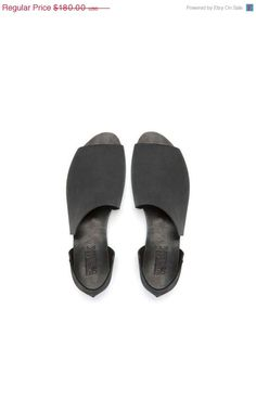 Black asymmetrical summer shoes