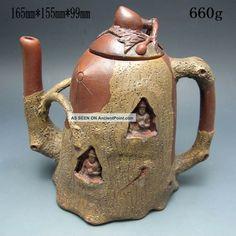 http://ancientpoint.com/imgs/a/b/b/w/t/chinese_zisha__purple_clay_teapot_w_mark_nrpc2052_1_lgw.jpg