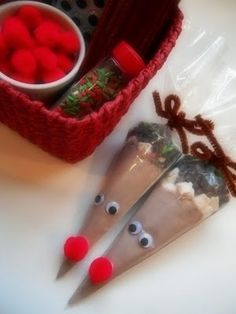 Reindeer hot cocoa cones. Put enough cocoa in a disposable pastry bag for 2 cups of cocoa. Top with some mini marshmallows, mini chocolate chips, and some sprinkles. Close with a brown chenille stem and tie into a bow.  Glue on googly eyes and a red pom pom nose.  Tie on a tag with directions for making the hot cocoa.