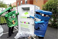 A bin for recycling clothing, flanked by two like-minded companions. #newyork #green #eco