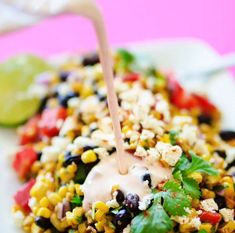 This Mexican Street Corn Salad is a healthy, simple take on elote, the delicious Mexican street vendor version of corn on the cob! #vegetarianrecipes #mexicanrecipes #texmex #healthy #cincodemayo #dinner #potluck // Live Eat Learn