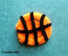 Super simple - regular orange pipe cleaner and thin black pipe cleaners