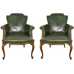 Pair of French Deco leather and mahogany armchairs - $1995.