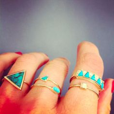 gold and turquoise rings.