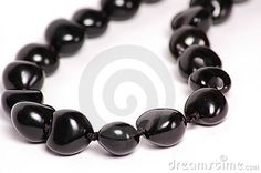 Real kukui nuts formed into a lei traditonally worn by Hawaiian royalty.  the real kukui nut is now rare and expensive.