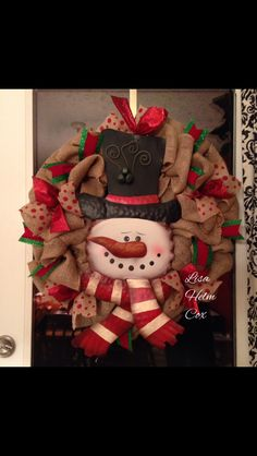 Burlap Snowman Wreath with red polka dot burlap ribbon & green/red accent ribbon.