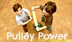 Making a simple pulley with a rolling pin and a piece of yarn.  Links to other simple machines given here as well.