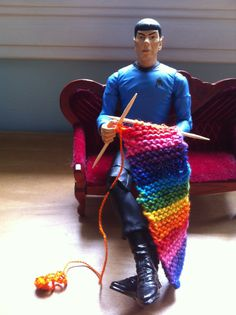 Spock knitting a rainbow scarf.