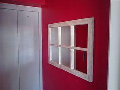 Espelho com moldura de janela