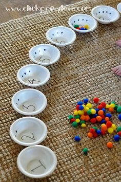 Click. Pray. Love: Toddler Activity #5: Counting with Bowls -    Things you'll need:  Plastic or Styrofoam bowls   Sharpie or Marker   Multiple objects that can fit inside the bowls (we used pom poms from Target's dollar section)