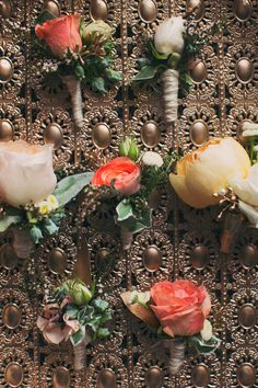 peach toned boutonnieres, photo by Alixann Loosle http://ruffledblog.com/blush-and-gold-utah-wedding #flowers #groom #groomsmen
