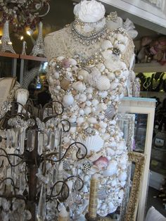 Dress form encrusted with shells and rhinestones..wow http://vignettesantiques.blogspot.ca/