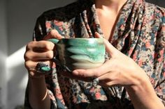 love this so much that i'm pinning it on a few different boards...the blouse (robe?), the mug, the jewelry...love love love!