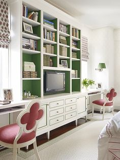 Study area, pop of emerald green in the bookcase.