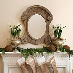 paperwhites blooming in silver urns, rustic mirror + fresh garland