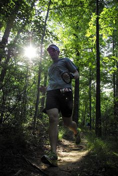 A runner dashes through the woods during the 2011 Scenic City Trail Marathon, TN
