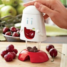 Cherry pitter that eats cherries and poops out the pits