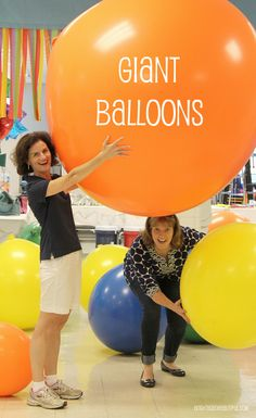 Summer party ideas like giant balloons and streamers are way too much fun!
