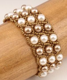 Instructions for Grand Duchess Bracelet      Beading by njdesigns1, 3 rows using pearls and seed beads. csa