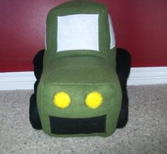 Free stuffed tractor toy pattern and sewn version.
