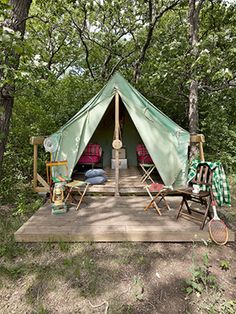 At Wandawega Lake Resort in Elkhorn, Wisconsin, guests can hang out in a platform tent, like this one, outfitted with cots, folding chairs, and coolers.