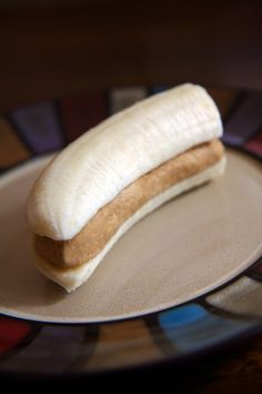 High-Protein Banana Peanut Butter Snack  Note: These can be premade and stored in the fridge to make this quick snack even faster.  High-Protein Banana Peanut Butter Snack INGREDIENTS  Half medium banana Half tablespoon peanut butter 1/2 oz. vanilla protein powder Water