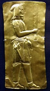 5th-4th c BCE Iranian Achaemenid Metalwork     ACHAEMENID Anonymous  (559 BCE - 331 BCE)      Gold plaque with soldier.  c. 500 BCE-300 BCE  Gold  Repoussé; cut  Achaemenid  Iran or Afghanistan.