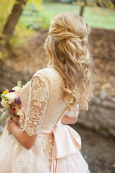 Bridal hair. Half up with a twisted upstyle, long curls. Added hair extensions for thickness  Carrie Purser Makeup and Hair Artistry Photo by Aya Photography