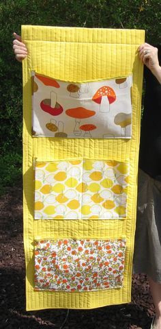 This wall hanging was designed for a nursery.  Also useful for a sewing area, maybe an office...