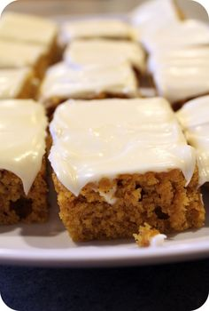 Pumpkin Bars with Cream Cheese Frosting 2 cups flour 2 teaspoons baking powder 2 teaspoons cinnamon 1/2 teaspoon nutmeg * 1 teaspoon salt 1 teaspoon baking soda 4 eggs 1 and 2/3 cups sugar 1 cup oil 1 can (15oz) pumpkin (not pumpkin pie filling) Directions: Sift dry ingredients (flour, baking powder, cinnamon, nutmeg, salt & soda) and set aside. In a large bowl, combine eggs, sugar, oil and pumpkin until light and fluffy. Add the dry ingredients, gradually. Mix well. Spread batter in a greas...