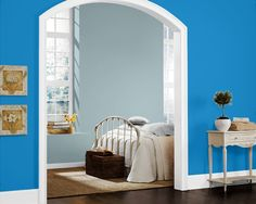 Try the Sherwin-Williams Color Visualizer to imagine what colors will look like. Use a photo of your own home, or try one of ours. Here we tried Dynamic Blue (SW 6958) in a hallway.