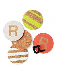DIY:: Personalized Coasters ~    Embellished cork coasters are a personal, practical hostess gift, protecting tables from guests' frosty glasses. Create stripes with masking tape and initials with vinyl letters. With a stencil brush, apply craft paint; let it dry; then remove tape or letter. Tie together with ribbon, and give with a bottle of wine.    From www.marthastewart.com/