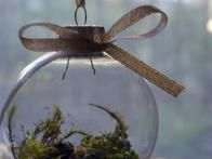 Get step by step instructions for making your own beautiful terrarium Christmas ornament.