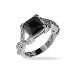 What a beautiful wedding ring. Black Onyx means protection.