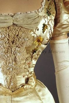 Evening Dress (detail), Mme Marie Reeves: ca. 1895-1897, American, satin, multicoloured Chinese floral embroidery, pearl and braid trim, inset chiffon. Search for 1983.001.0209 ab