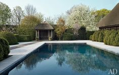A simple thatched pool pavilion sits adjacent to the Japanese dwelling. Interior design by Axel Vervoordt and grounds by landscape firm Wirtz International