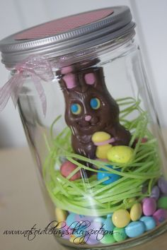 Canning jar with chocolate bunny, your choice of Easter-colored candies and edible grass.  Cute gift!
