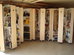 Two car garage storage: Cabinets on casters.