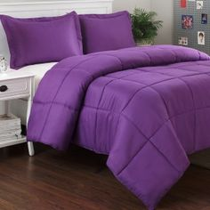 The  solid color Purple Mini Comforter Set features a soft micro   ...