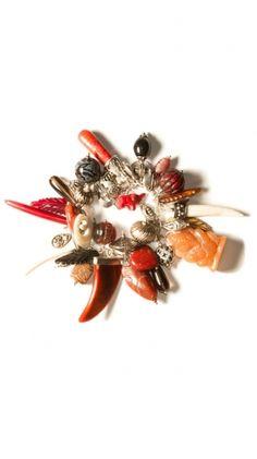 "Exotic Charm Bracelet with Red Adventurine, Smoke Quartz, Carnelian, Wood, Vintage Glass, Horn, Bone, Indonesian Wound Glass  7.5""  $200"