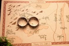 WOW. At an LotR themed wedding, maps in the style of JRR Tolkien. This is beyond gorgeous. lotr wedding theme, style, maps, themed weddings, tolkien wedding, lotr wedding ideas, lotr theme, jrr tolkien
