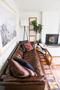 house tours, living rooms, kilim rug pillow sofa, leather sofas, white walls leather couch, leather sofa decor, california houses, live room, light walls leather couches
