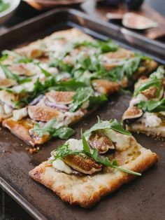 Fig, Jalapeño Jam and Blue Cheese Pizza | www.kitchenconfidante.com All the flavors I adore are on this pizza. Sweet figs, spicy jalapeño jam, and earthy blue cheese melt together with the crunch of red onion and peppery arugula for a symphony of flavors in each bite.