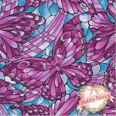 """Light Fantastic 852-4 by Fabric Freedom: Light Fantastic is a collection by Fabric Freedom. 100% cotton. 43/44"""" wide This fabric features stained glass purple butterflies on a blue background."""