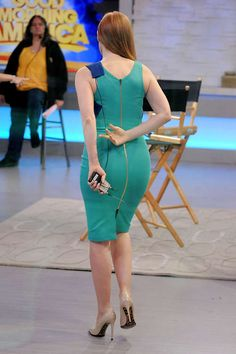 Jessica Chastain in a figure hugging green dress and nude pumps