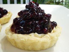 Saskatoon Tarts with cream cheese filling and boozy berries