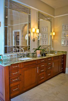 Dual sink and mirror bathroom. Not a fan of counter color