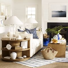 Light and airy natural hues are accented with touches of navy to create a fresh, summer seaside style.