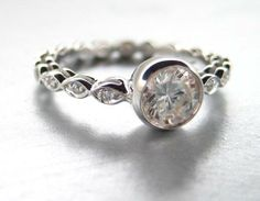 Bezel set #engagement ring with white sapphire and #diamonds