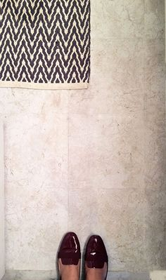 Peel and stick vinyl flooring is an easy way to upgrade the look of your bathroom. Click through to see how designer Ellie Somerville McNevin put vinyl tiles over the old tiles in her rental home's master bath... part of her simple and inexpensive bathroom upgrade.
